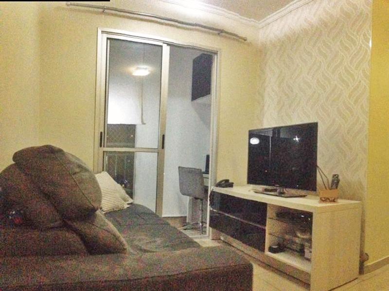 Jabaquara, Apartamento Padrão - Sala com dois ambientes, piso de cerâmica e teto com moldura de gesso.