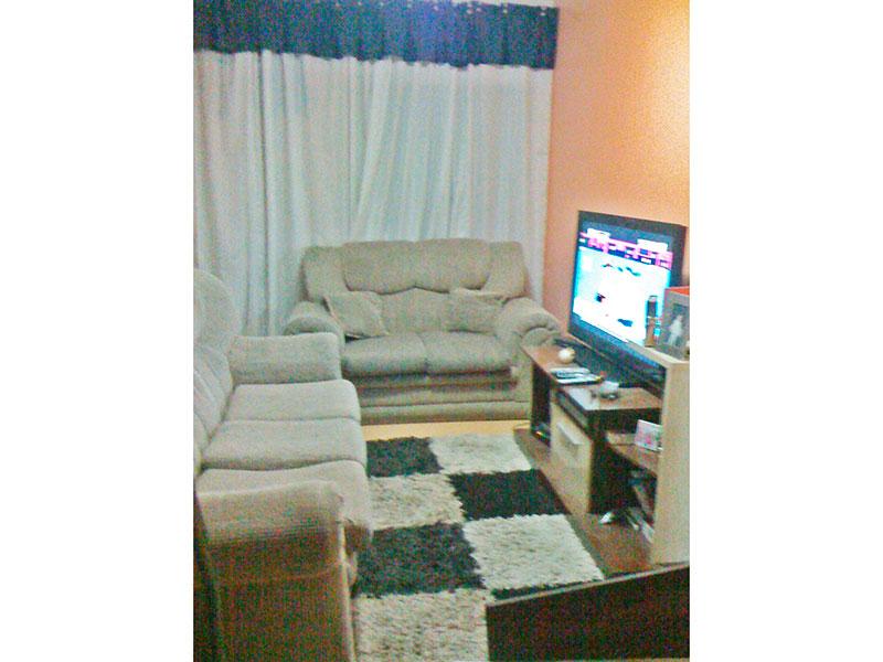 Jabaquara, Apartamento Padrão - Sala com piso laminado e acesso a sacada.