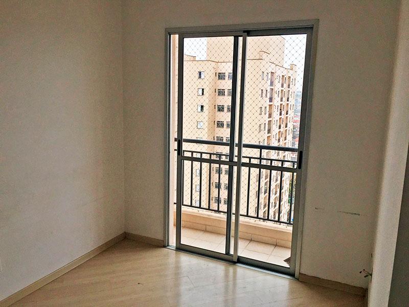 Jabaquara, Apartamento Padrão - Sala em L com piso laminado e acesso a varanda.
