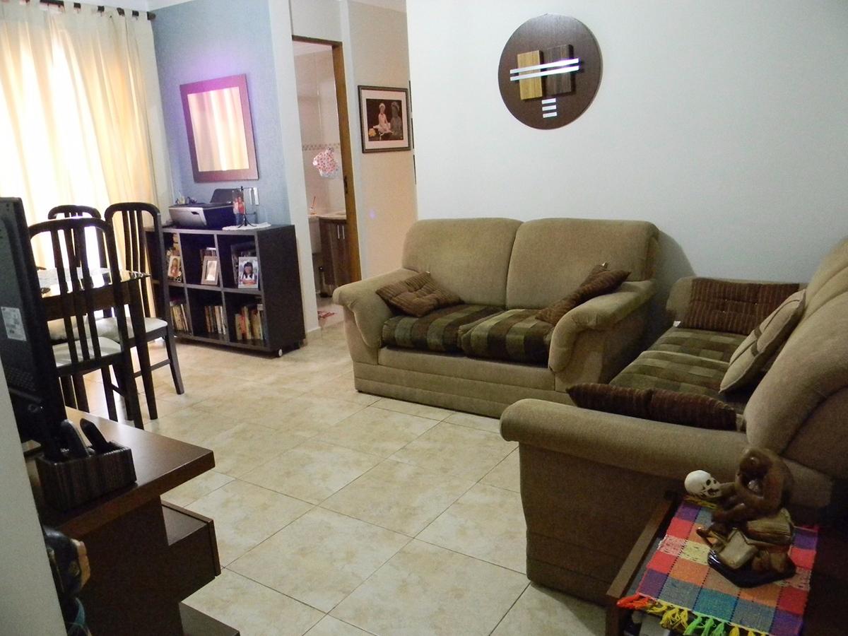Jabaquara, Apartamento Padrão - Sala com dois ambientes, piso de cerâmica, teto com moldura de gesso e acesso à varanda.