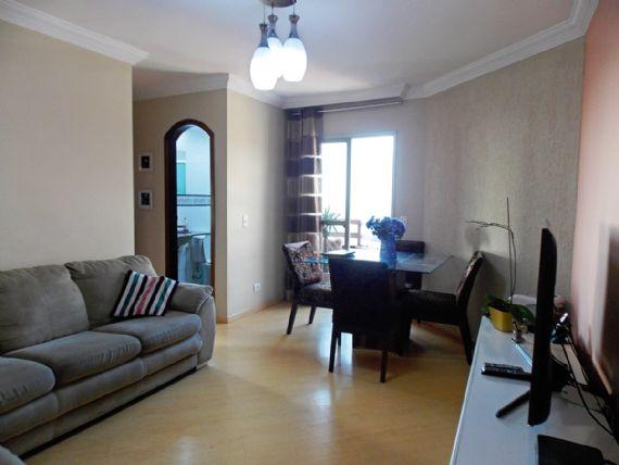 Jabaquara, Apartamento Padrão - Sala em L com dois ambientes, piso laminado, teto com moldura de gesso e acesso à varanda.
