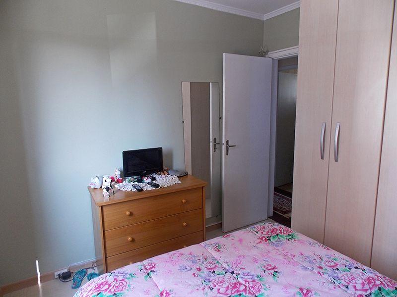Sacomã, Apartamento Padrão-Primeiro segundo dormitório com piso laminado, teto com moldura de gesso e armários planejados.