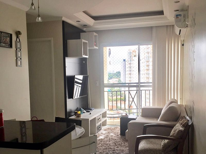 Cursino, Apartamento Padrão - Sala em L com piso de porcelanato, teto com sanca de gesso, iluminação embutida e acesso à varanda.