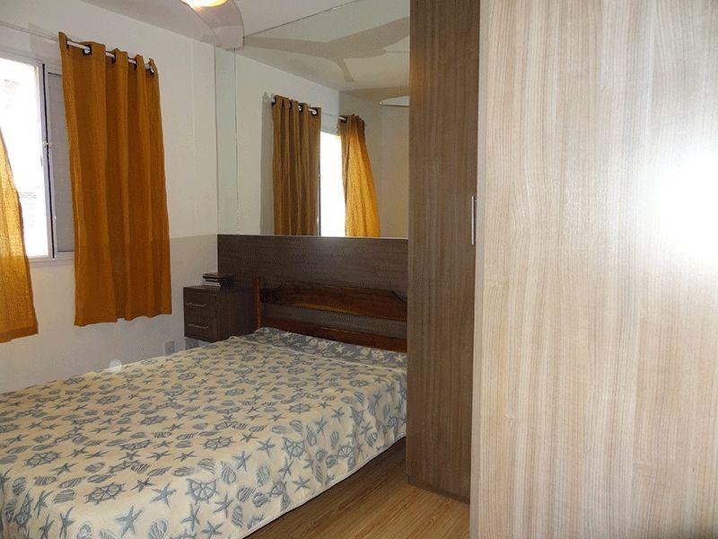 Ipiranga, Apartamento Padrão-Segundo dormitório com piso laminado e armários planejados.