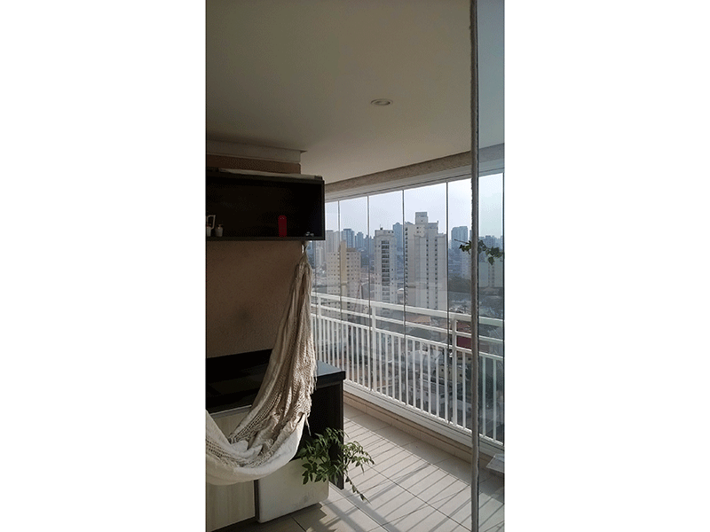 Ipiranga, Apartamento Padrão-Varanda gourmet com piso de cerâmica, pia de granito com gabinete e cortina de vidro.