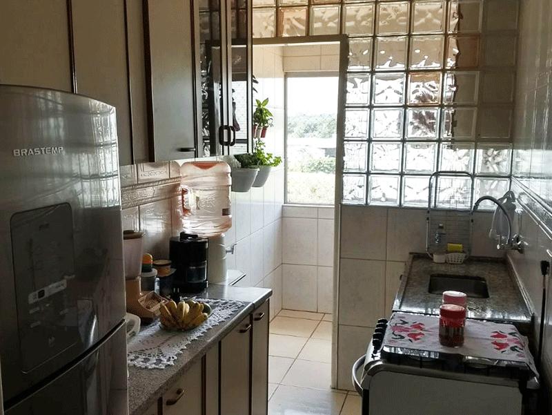 Jabaquara, Apartamento Padrão-Cozinha com piso de cerâmica e pia de granito com gabinete.