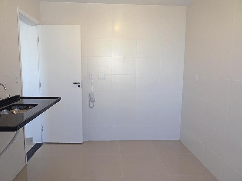 Jabaquara, Apartamento Padrão-Cozinha com piso de porcelanato e pia de granito.