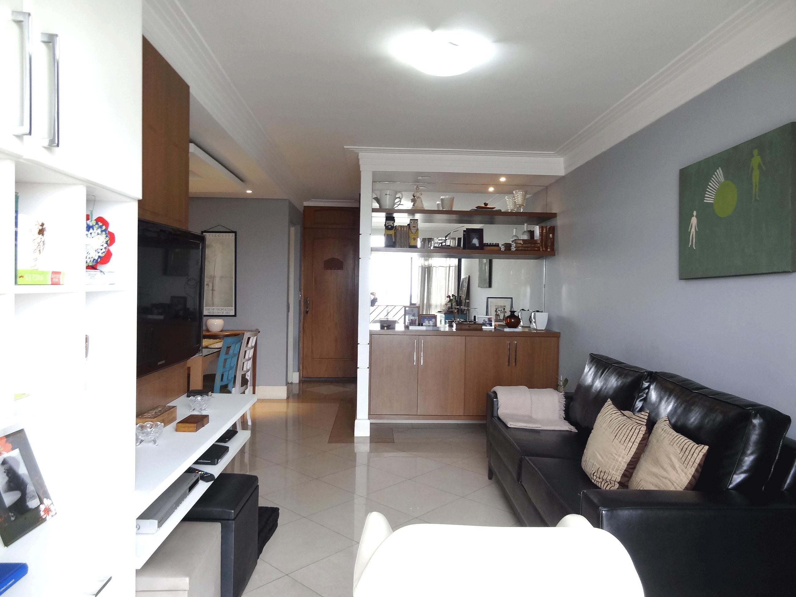 Jabaquara, Apartamento Padrão-Sala em L com piso de porcelanato, teto com sanca de gesso, iluminação embutida e acesso à varanda.