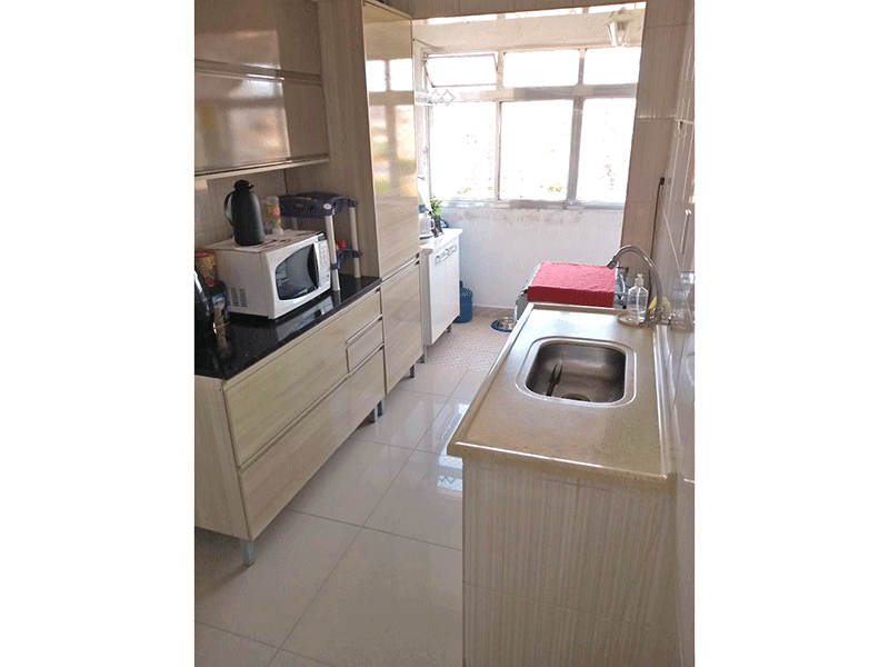 Ipiranga, Apartamento Padrão-Cozinha com piso de porcelanato, pia com gabinete e armários planejados.