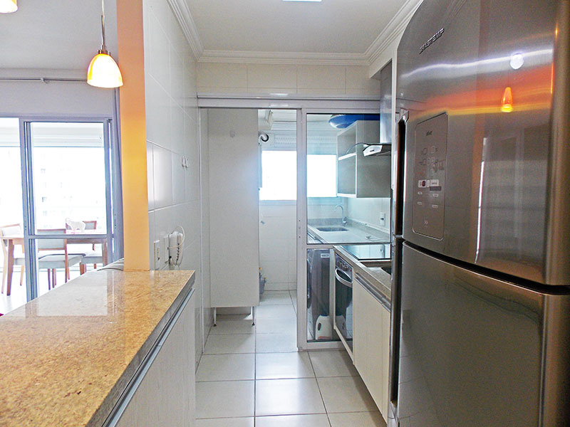 Jabaquara, Apartamento Padrão-Cozinha americana com piso de cerâmica, teto com moldura de gesso, armários planejados, cooktop, gabinete,pia de granito e acesso a área de serviço.