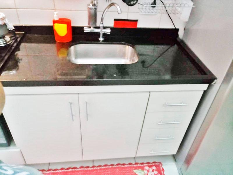 Jabaquara, Apartamento Padrão-Cozinha integrado com a área de serviço, com piso de cerâmica, gabinete, cooktop e pia de granito