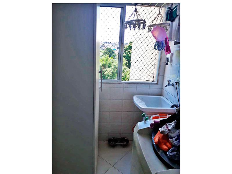 Sacomã, Apartamento Padrão-Área de serviço com piso de porcelanato e armários planejados.
